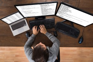 Man Stealing Data From Computers And Laptop
